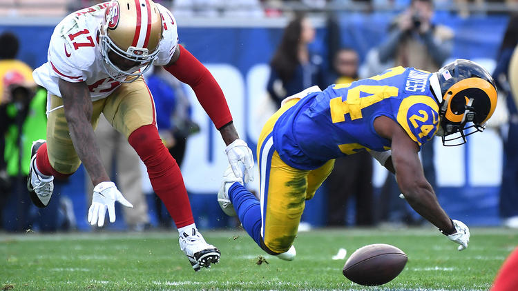 Rams defensive back Blake Countess, right, is called for pass interference as he breaks up a pass during the second quarter. To see more images from the game, click on the photo above. (Wally Skalij / Los Angeles Times)