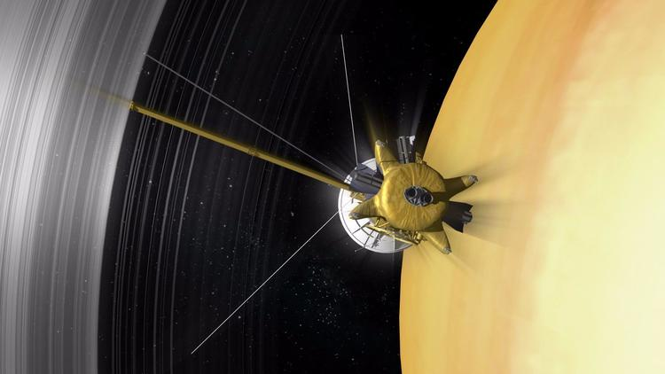 An artist's concept shows Cassini's final orbits between the innermost rings and Saturn's cloud tops.