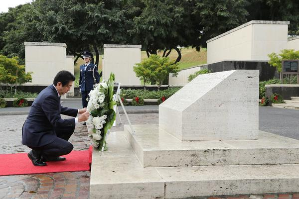 Japanese Prime Minister Shinzo Abe at the National Memorial Cemetery of the Pacific in Honolulu on Monday. (AFP/Getty Images)