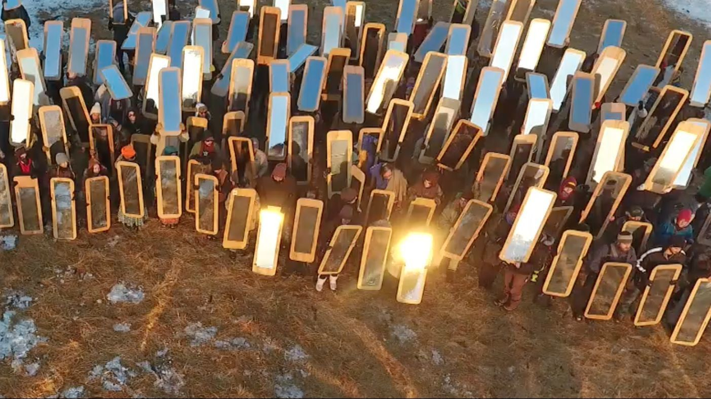 Protestors hold the mirrored shields devised by artist Cannupa Hanska Luger, who was born on the Standing Rock Reservation. (UnKnown Collective / Cannupa Hanska Luger)