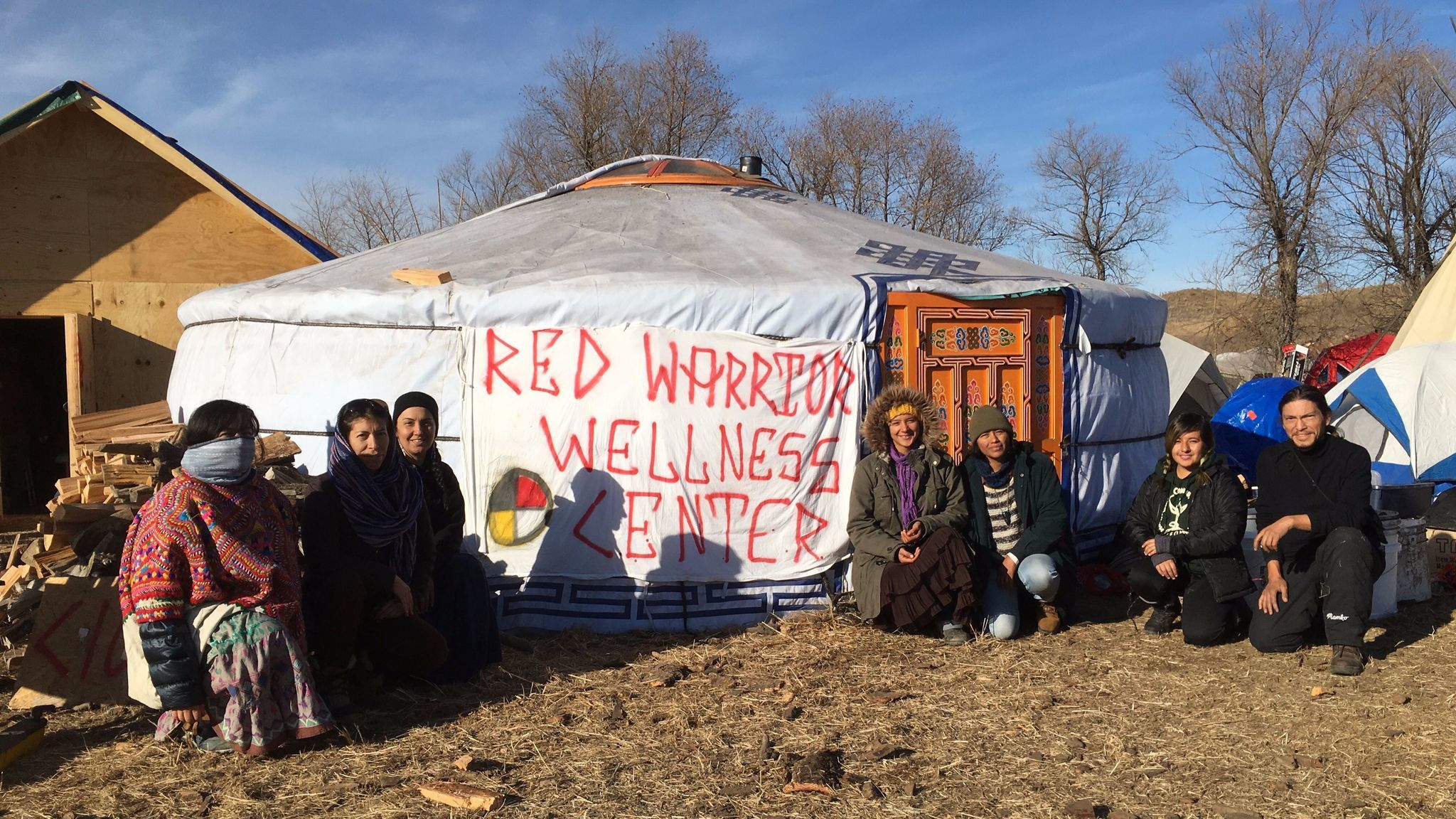 Artists and healers gather before a pop-up wellness center at the Red Warrior Camp at Standing Rock. (Joel Garcia)