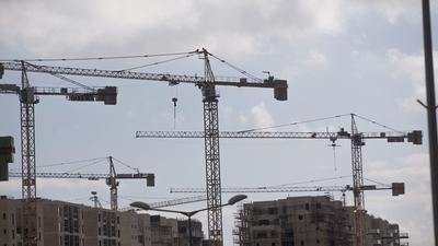 Undaunted by U.N. rebuke, Israel to continue building settlements