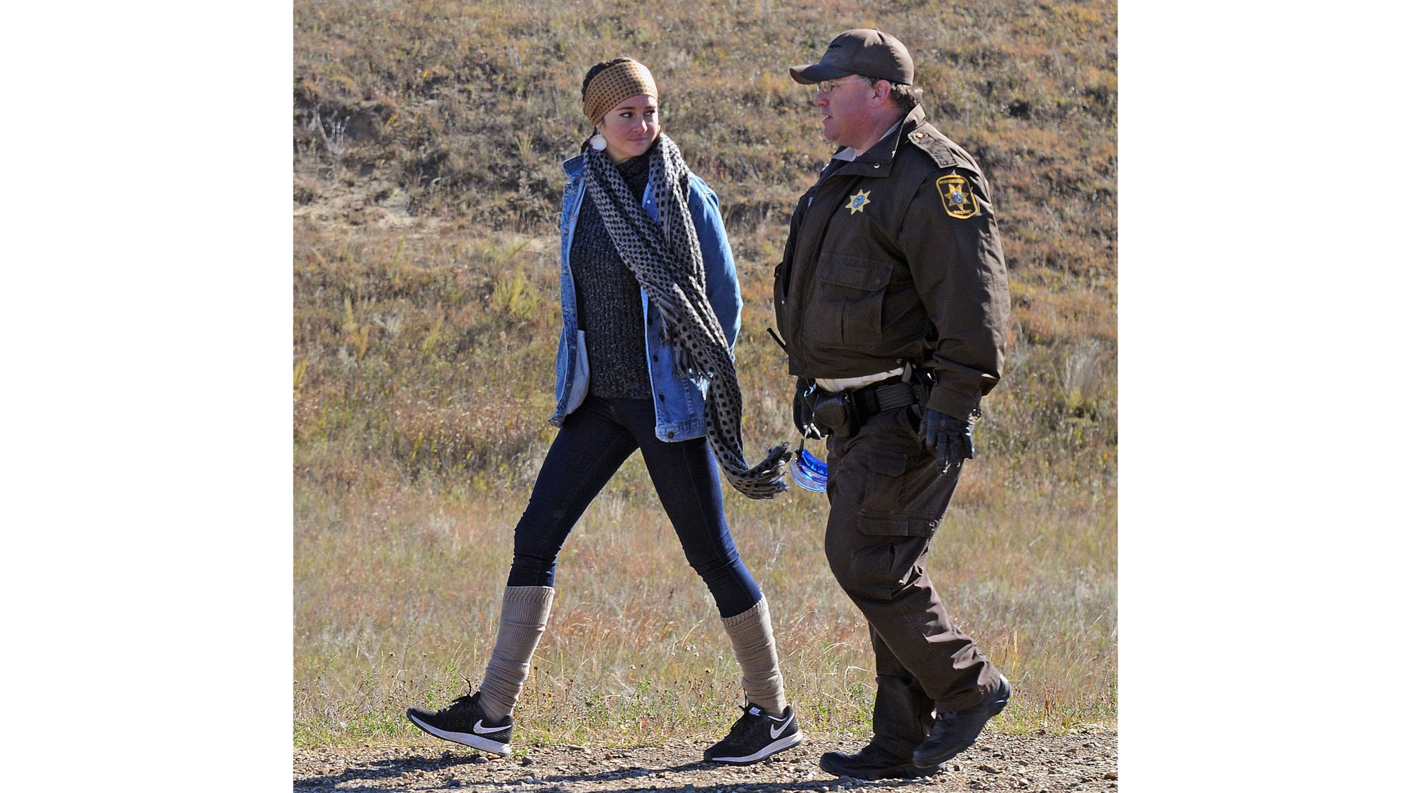 Shailene Woodley is arrested by a Morton County sheriff's deputy near St. Anthony, N.D., in October. (Tom Stromme / Bismarck Tribune)