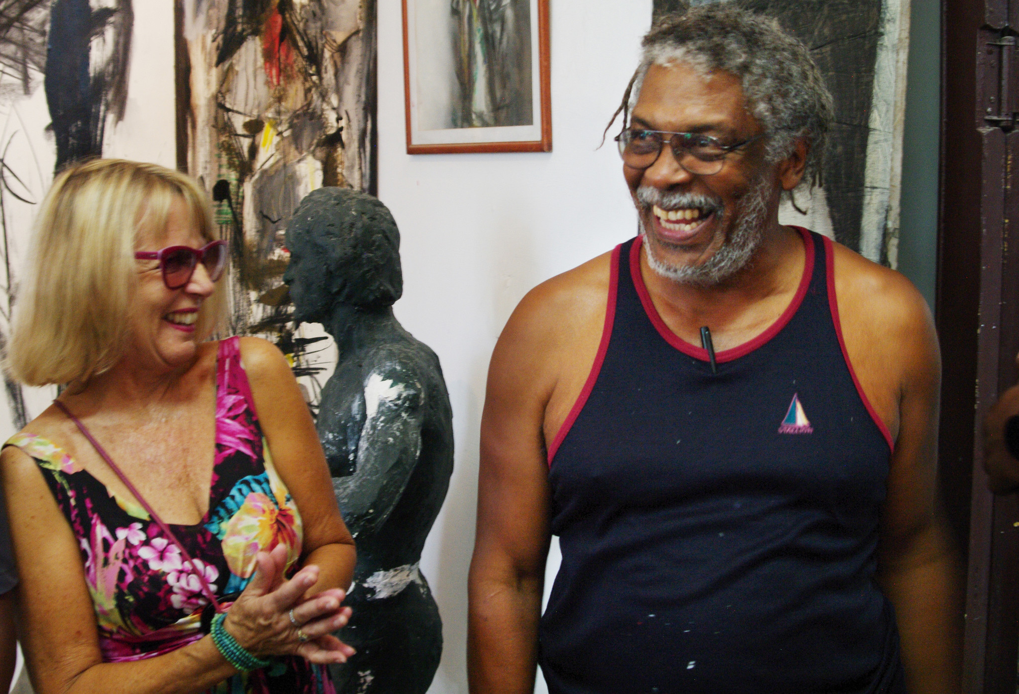 Cuban artist Alberto Lescay at his workshop with Nancy Covey, who brought a group of U.S. visitors to Cuba to explore the country's music and art scene.