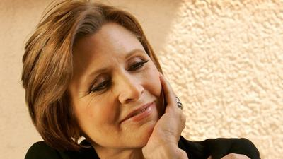 Carrie Fisher, child of Hollywood who blazed a path as 'Star Wars' heroine, screenwriter and author, dies at 60