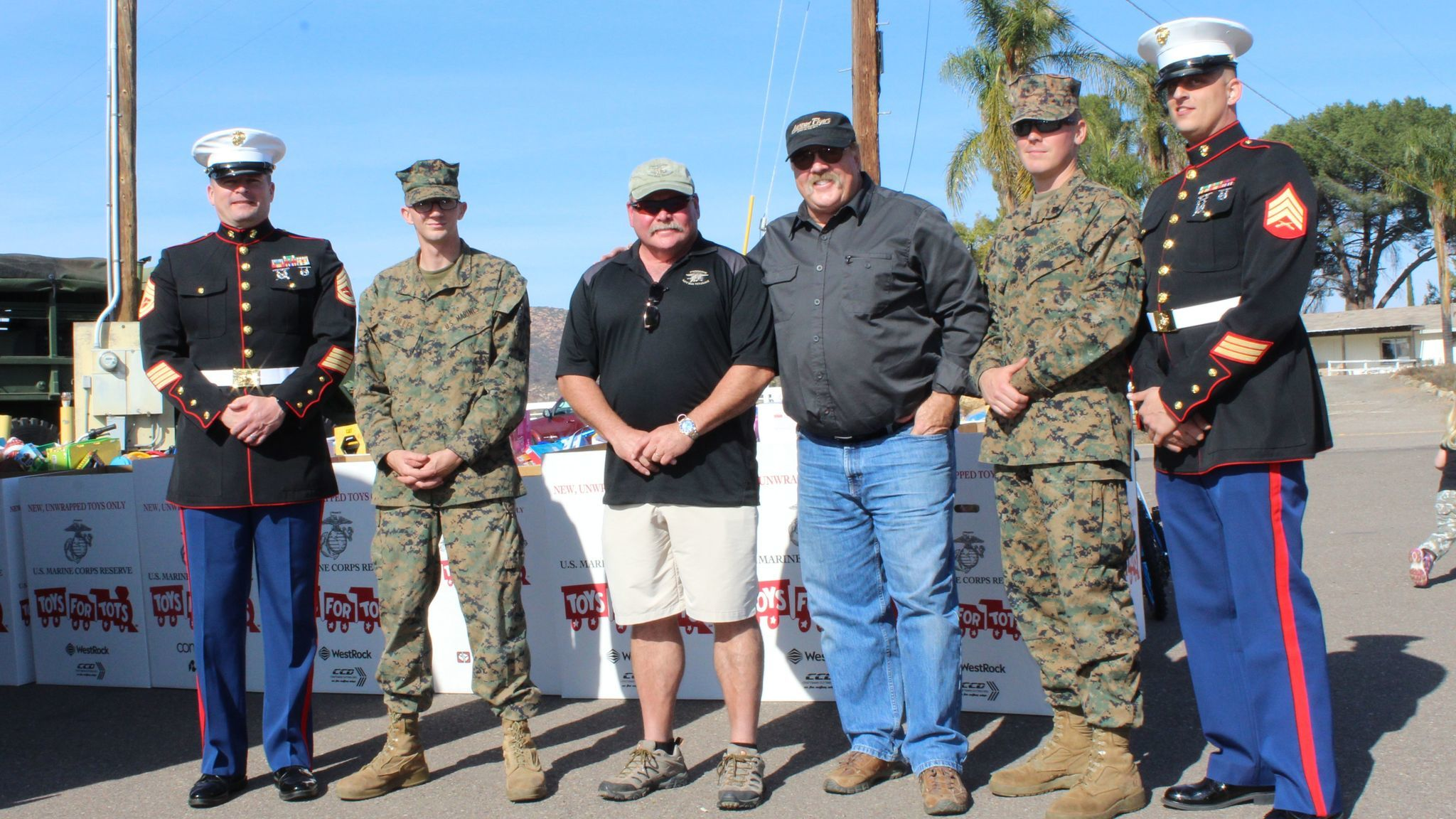 Pilots Rick Sullivan and Mike Johnson visit with Gunnery Sgt. Warren Arnett, Lance Cpl. Andrew Fuller, Sgt. Keith Babudar and Sgt. Jon Cole.