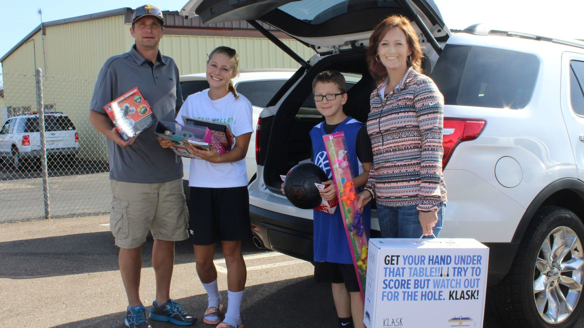 Ramona residents Cameron and Kami Douglas with their children, Kiersten, 14, and Brance, 10, deliver toys. Cameron Douglas is a Cal Fire pilot.