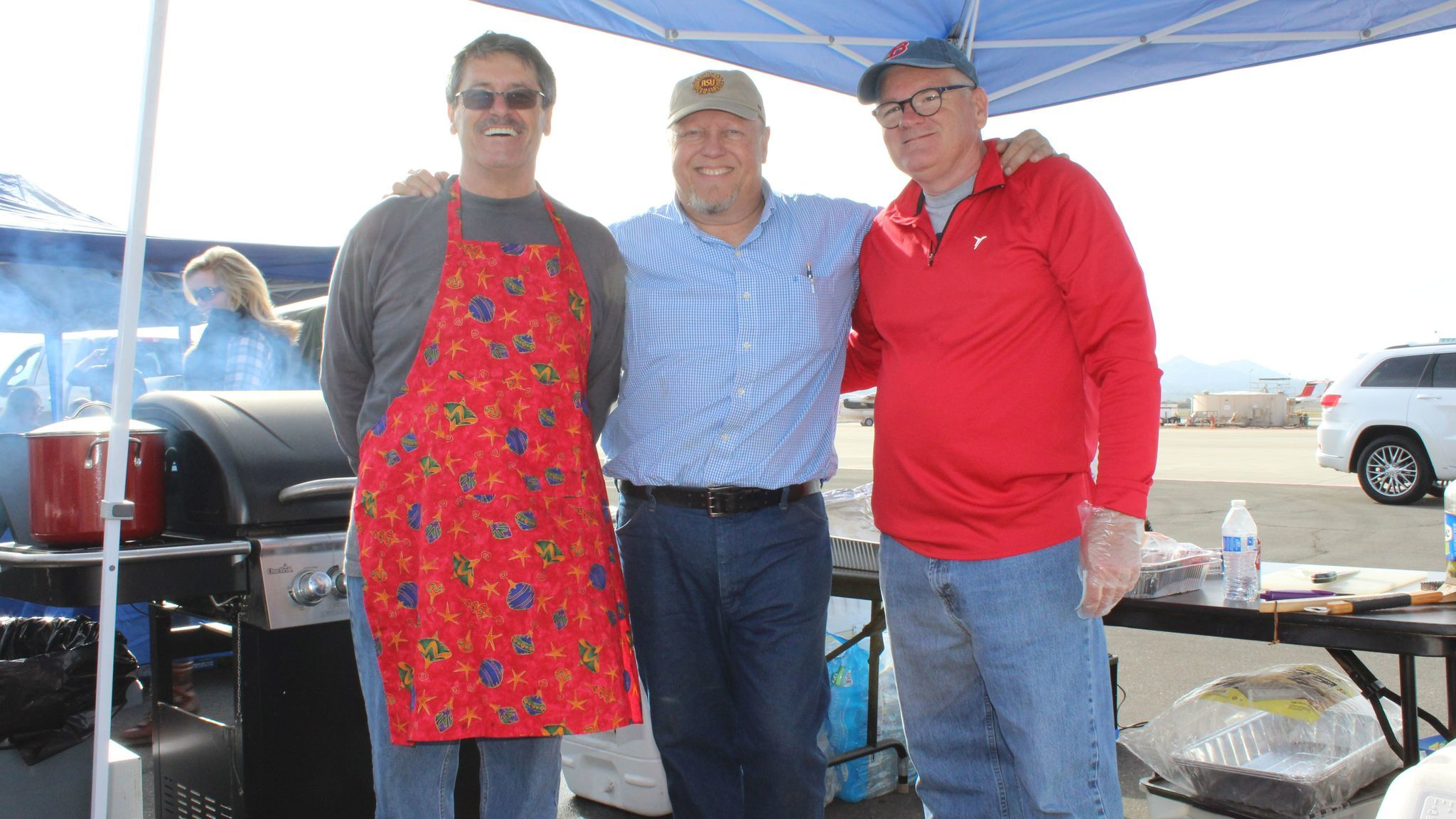 Martin Wood, center, stands by the food station with Joe Patrao and Frank Provost.