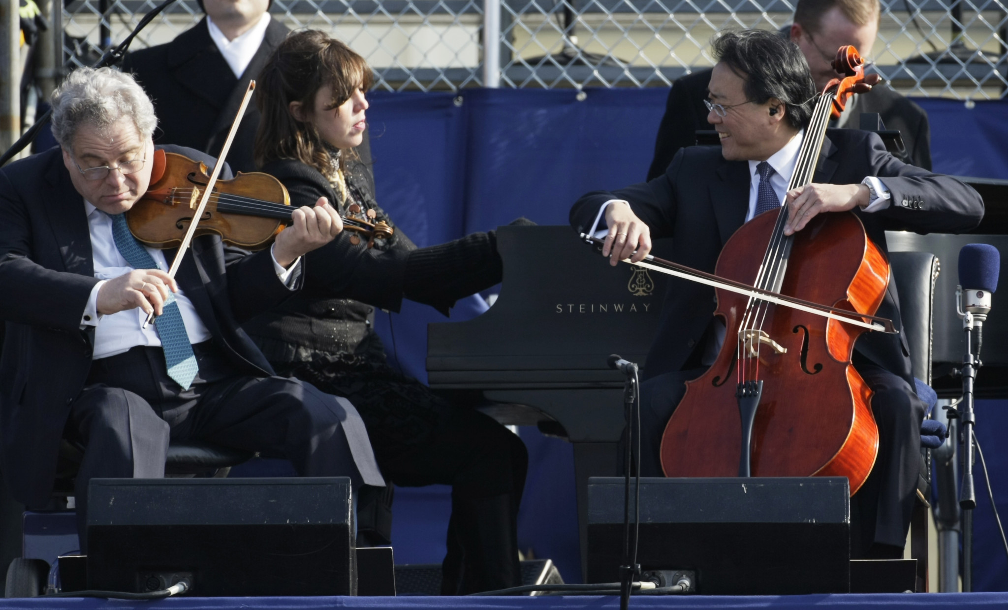 "Cellist Yo-Yo Ma, right, violinist Itzhak Perlman, left, and pianist Gabriela Montero perform John Williams' ""Air and Simple Gifts"" during the  inauguration of Barack Obama on the West Front of the Ca (Alex Wong / Getty Images)"