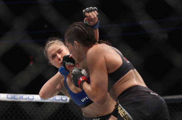 Amanda Nunes puts Ronda Rousey on the defensive during their bantamweight title bout on Friday night at UFC 207. (Christian Petersen / Getty Images)