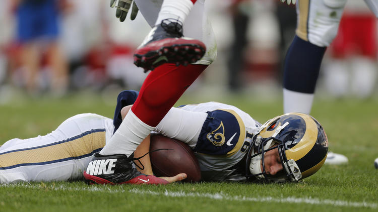 Rams quarterback Jared Goff is slow to get up after being sacked by Cardinals defensive end Calais Campbell. To see more images from the game, click on the photo above. (Gina Ferazzi / Los Angeles Times)