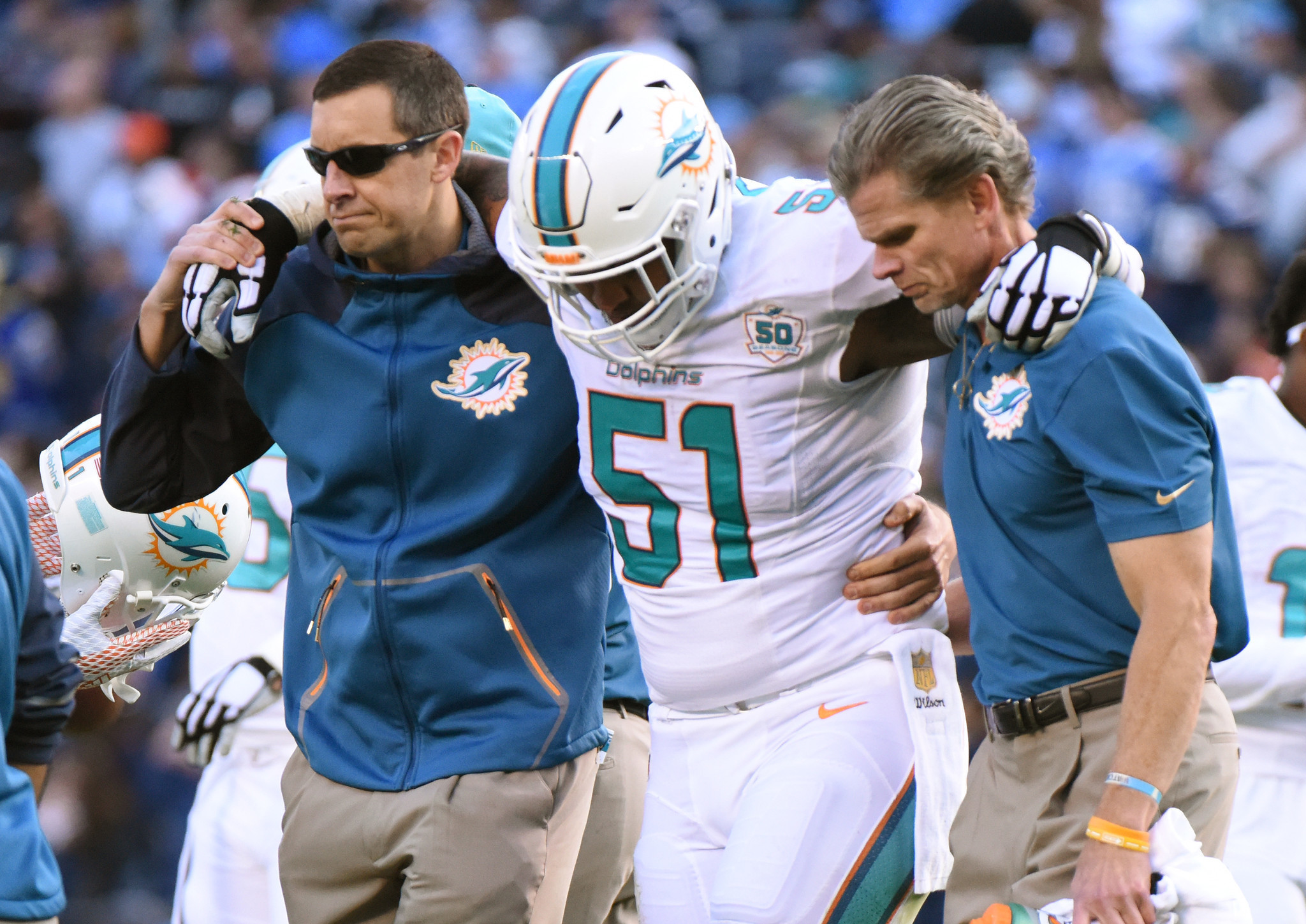 Injured Dolphins vets Mike Pouncey Reshad Jones and Koa Misi will