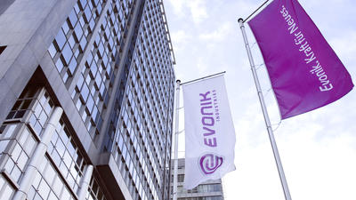 What is Evonik and what is it acquiring from Air Products?