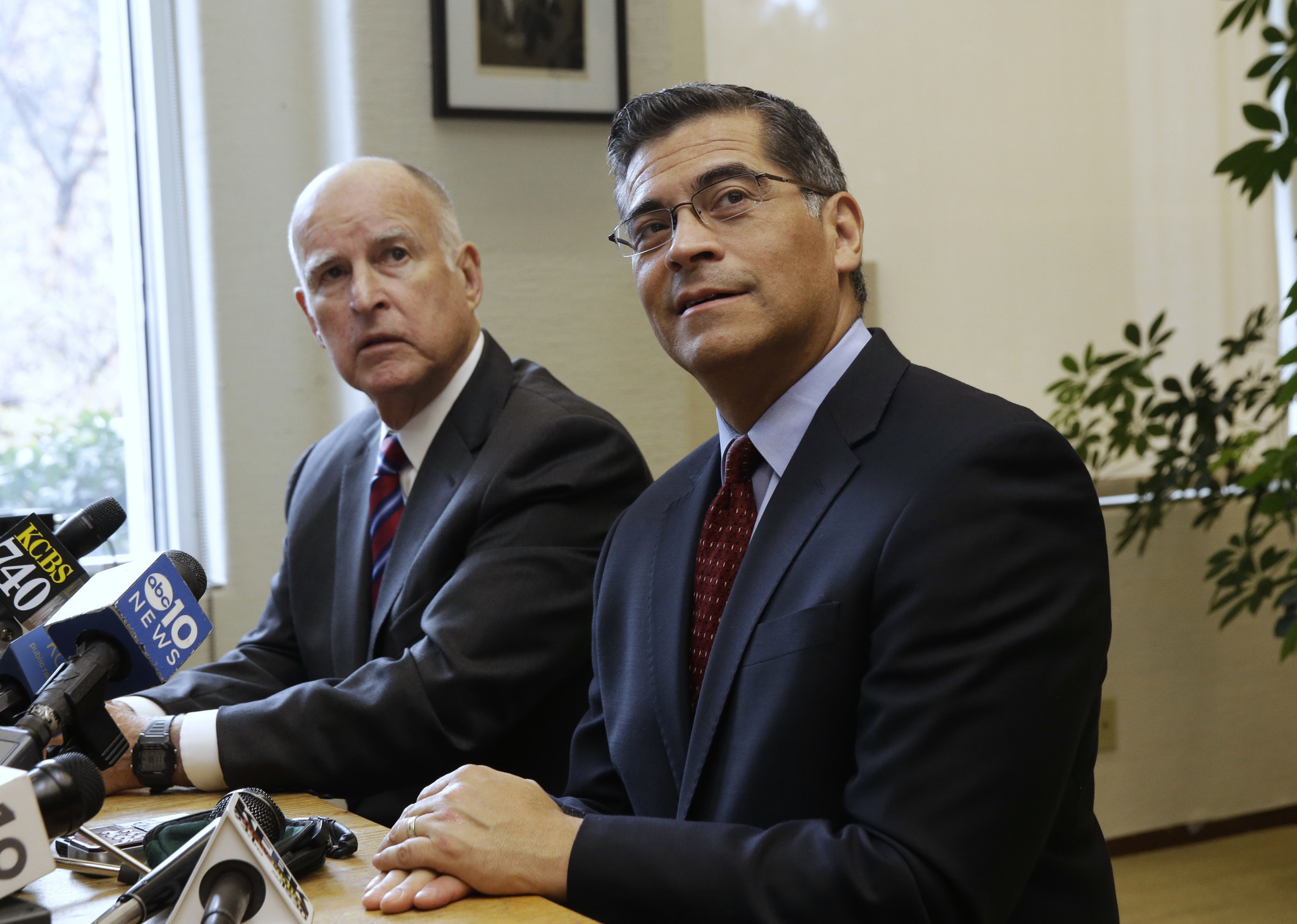 Gov. Jerry Brown, left, and Rep. Xavier Becerra (D-Los Angeles), Brown's nominee for state attorney general, at a news conference last month. (Rich Pedroncelli / Associated Press)