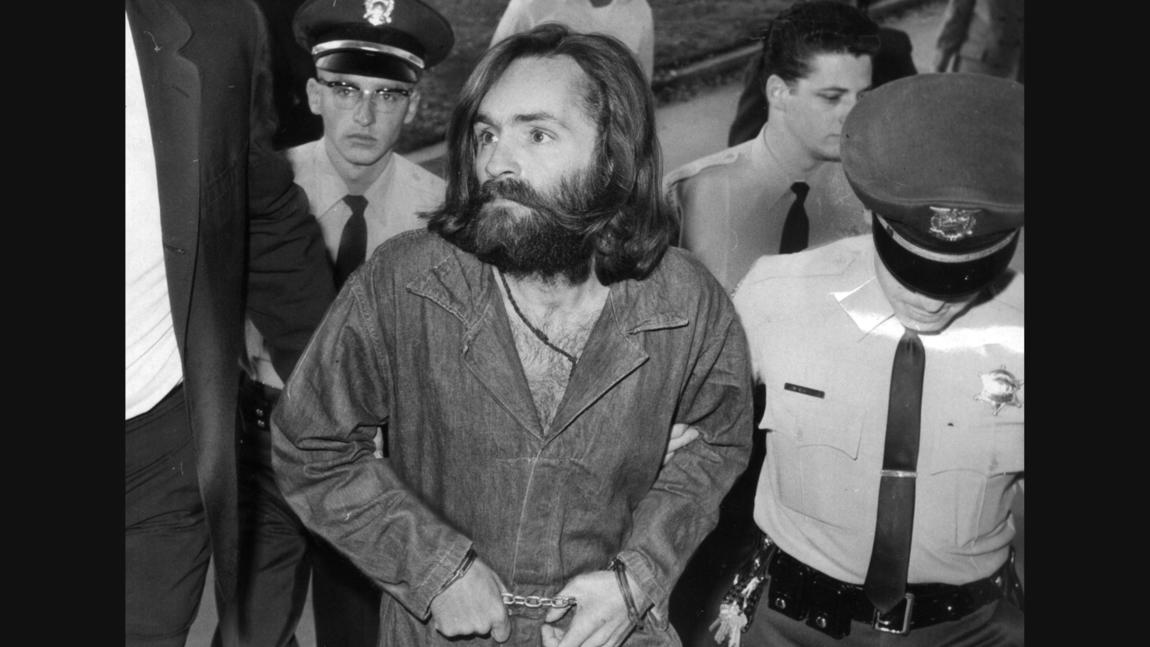 Charles Manson is escorted to court for a preliminary hearing in 1969
