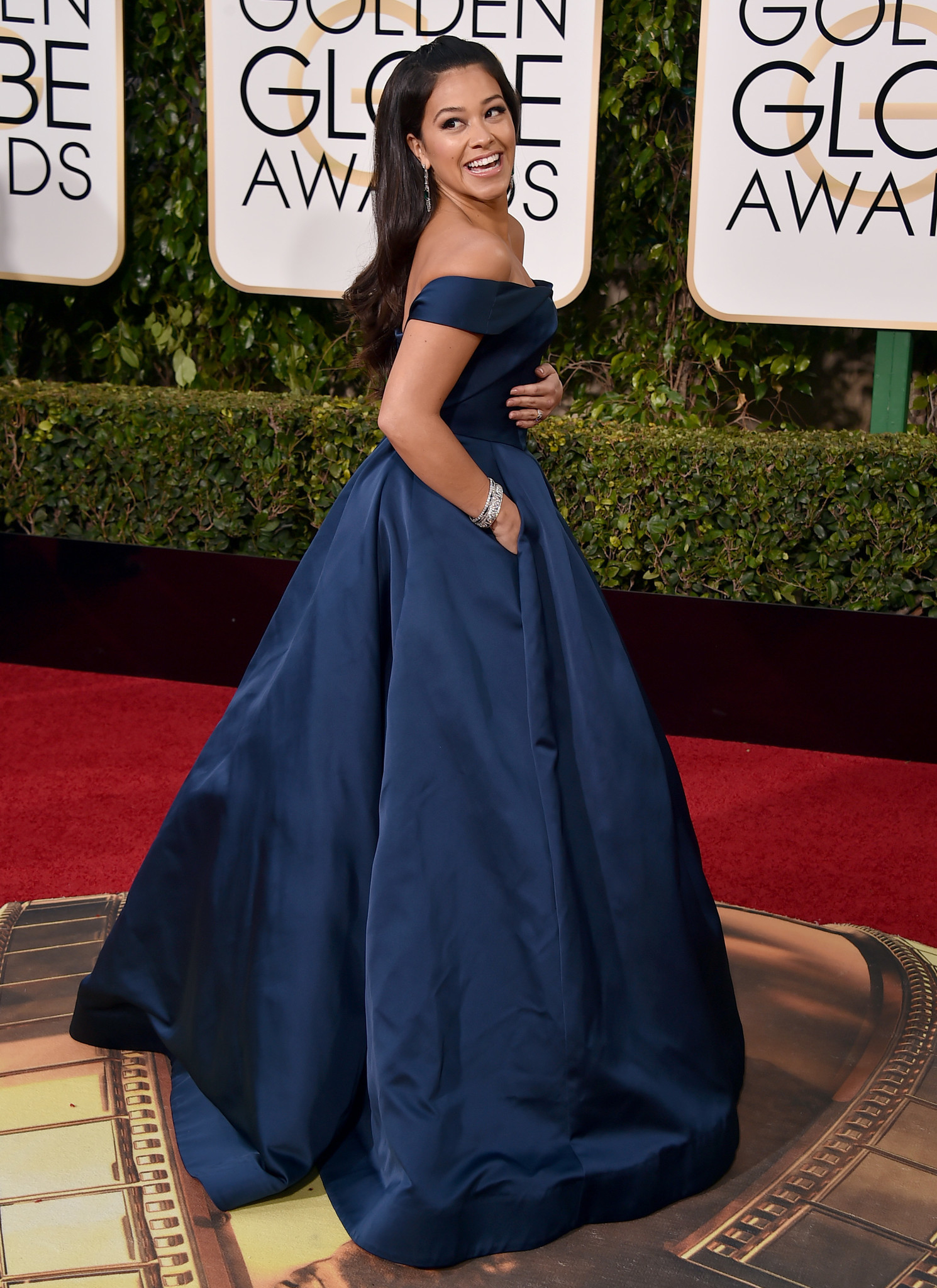 A Celebrity Walking Down The Red Carpet At Golden Globe Awards