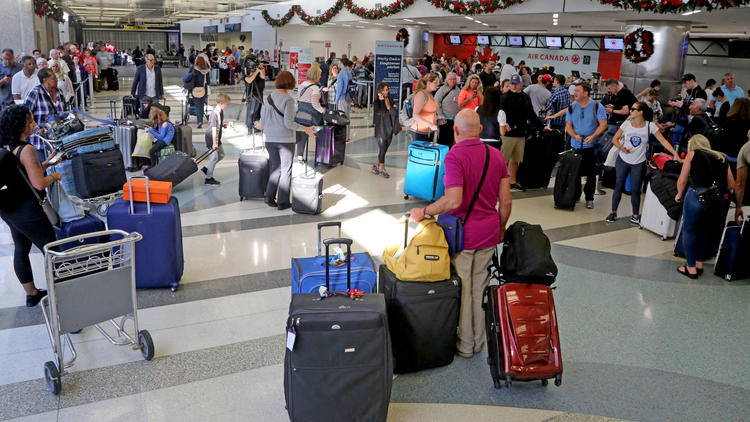 Travelers dealing with lost belongings and long lines after airport shooting