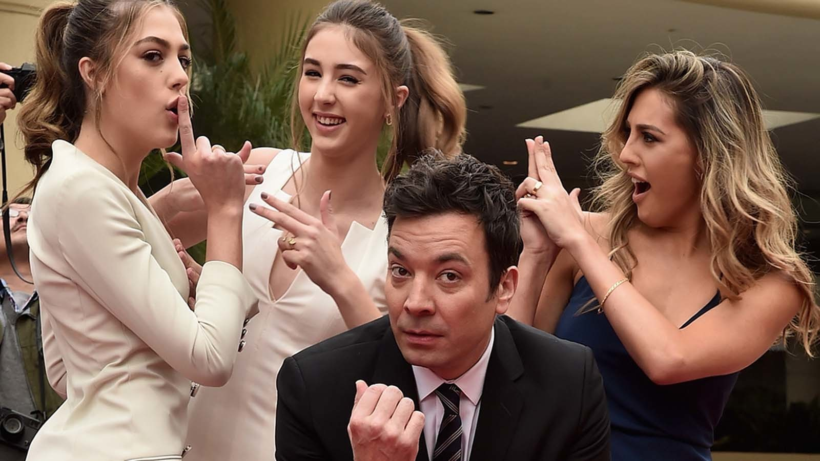 """From left, sisters Sistene, Scarlet and Sophia Stallone do their best """"Charlie's Angels"""" impersonations, with Jimmy Fallon as Bosley. (Alberto E. Rodriguez / Getty Images)"""