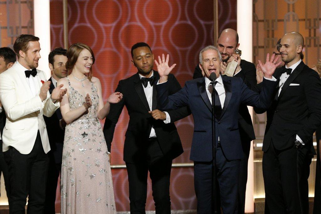 Actors Ryan Gosling, from left, Emma Stone and John Legend and producers Marc Platt, Jordan Horowitz and Fred Berger at the Golden Globes. (Getty Images)