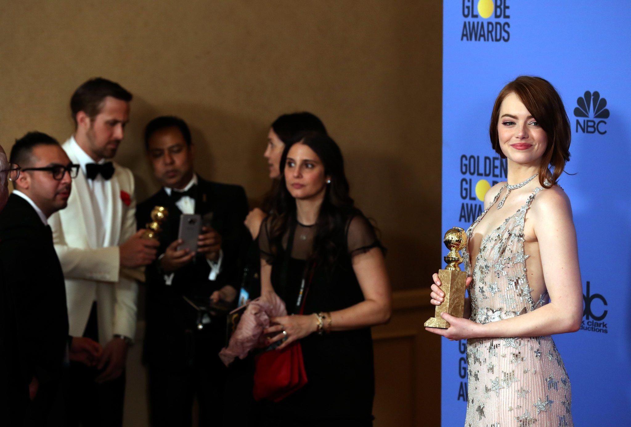 Emma Stone with her Golden Globe Award. (Mike Nelson / EPA)