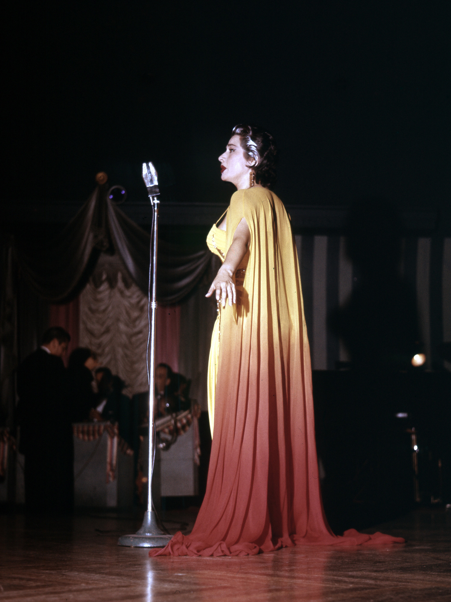 Sumac was known for her glamorous, queenly outfits — seen here in 1957.