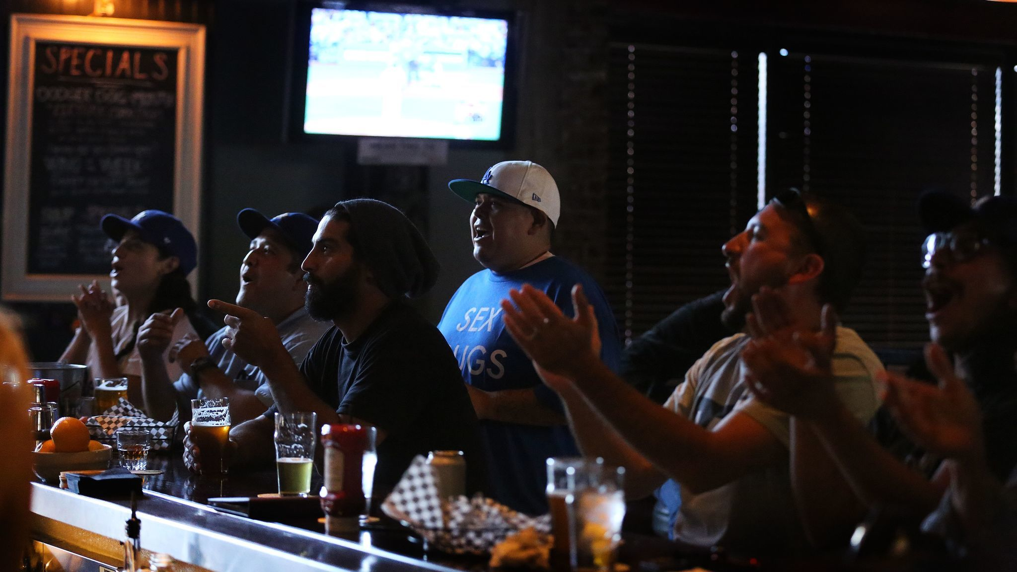 Fans enjoy a game and beers inside the Greyhound Bar & Grill in Los Angeles.