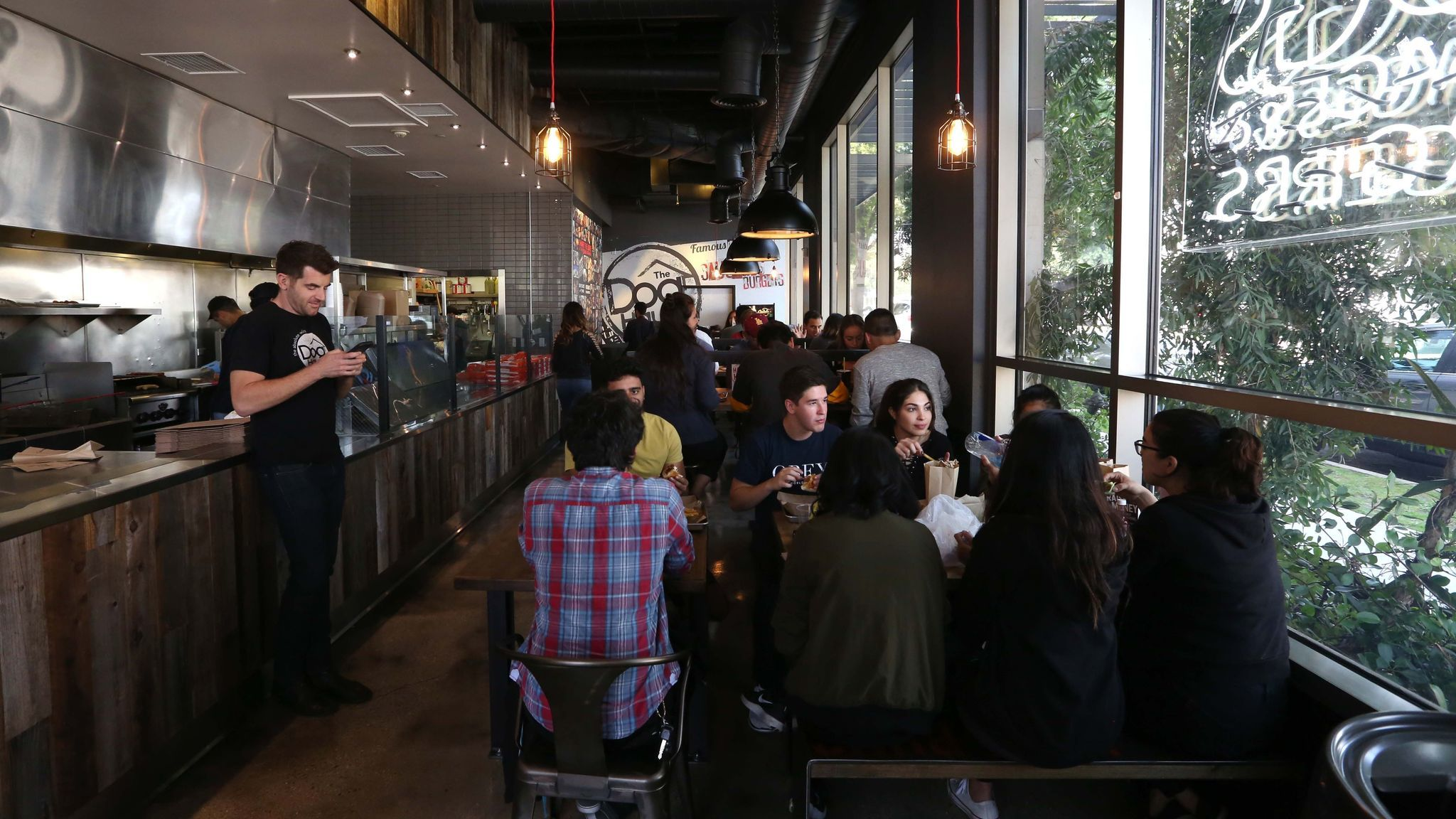 Patrons dine at Dog Haus in Pasadena.