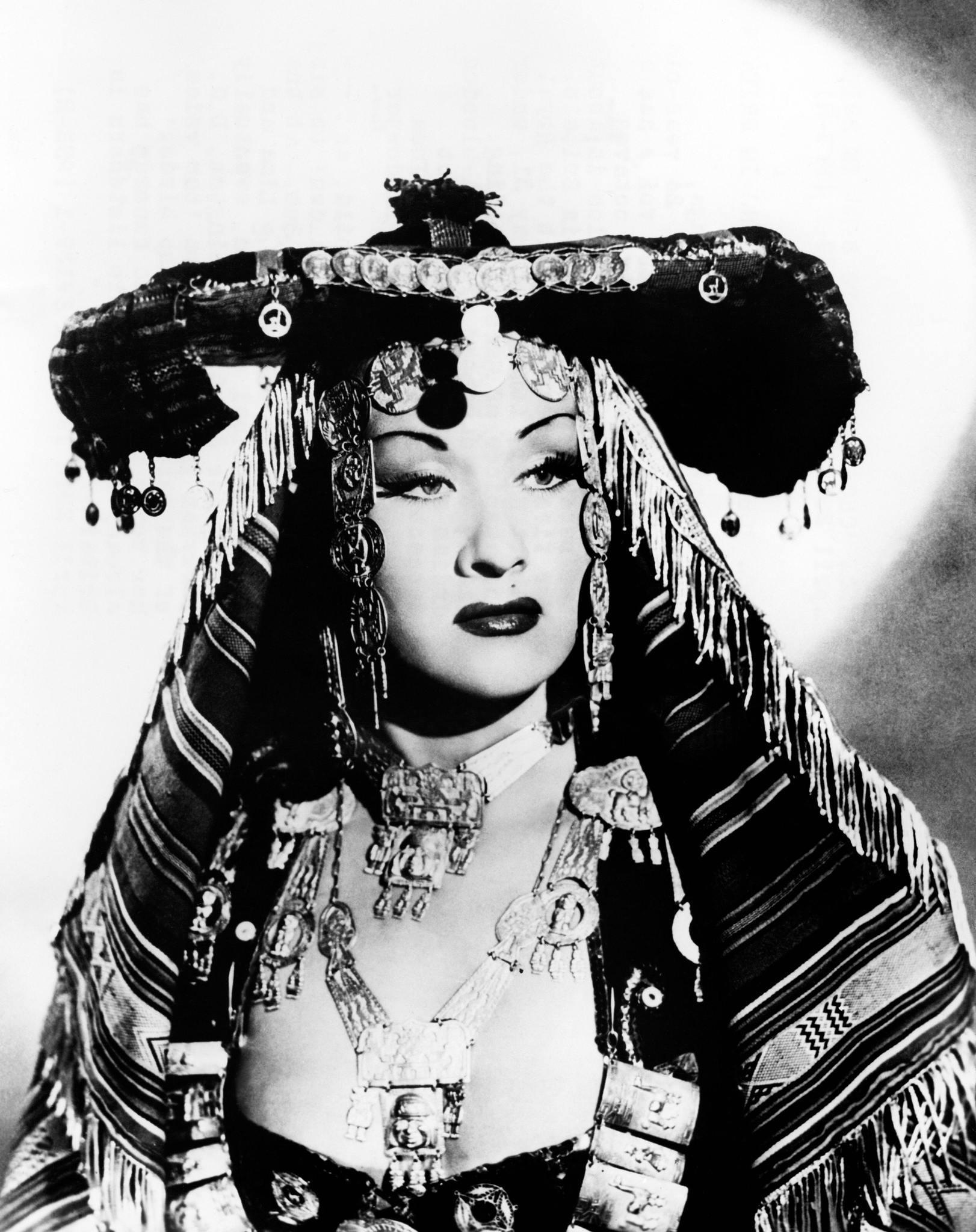 Peruvian singer Yma Sumac in indigenous-style regalia in 1952.