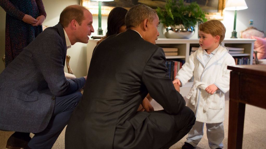 In this handout provided by The White House, President Barack Obama, Prince William, Duke of Cambridge and First Lady Michelle Obama talks with Prince George at Kensington Palace on April 22, 2016 in London, England.