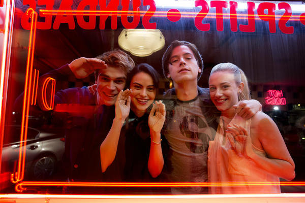 "KJ Apa as Archie, Camila Mendes as Veronica, Cole Sprouse as Jughead, and Lili Reinhart as Betty in ""Riverdale."" (Katie Yu / CW)"