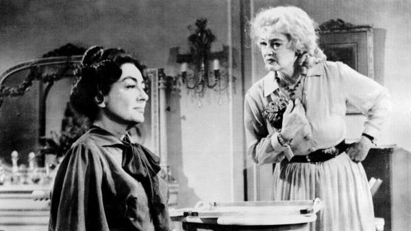 "Joan Crawford, left, and Bette Davis appear in a scene from ""What Ever Happened to Baby Jane?"" in 1962. (Warner Bros.)"