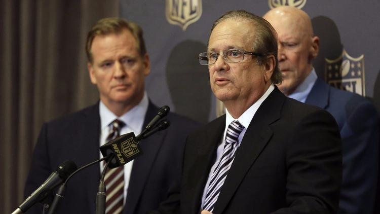 San Diego Chargers owner Dean Spanos talks to the media last year, with NFL Commissioner Roger Goodell looking on. (Pat Sullivan / Associated Press)