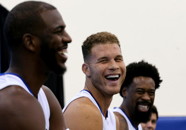 Clippers starters Chris Paul, left, Blake Griffin and DeAndre Jordan share a light moment while talking with reporters on media day on Sept. 25, 2015. (Luis Sinco / Los Angeles Times)