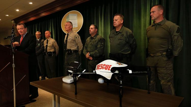 Los Angeles County Sheriff Jim McDonnell, left, introduces the department's new unmanned aerial vehicle, which will be used to aid deputies responding to suspicious packages and hazardous material incidents, among other situations.