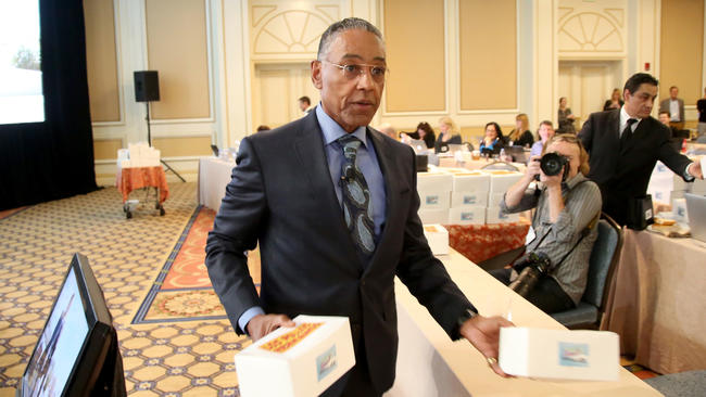 Actor Giancarlo Esposito passes out boxes of Los Pollos Hermanos chicken during the 'Better Call Saul' panel at the Television Critics Assn. press tour. (Frederick M. Brown / Getty Images)