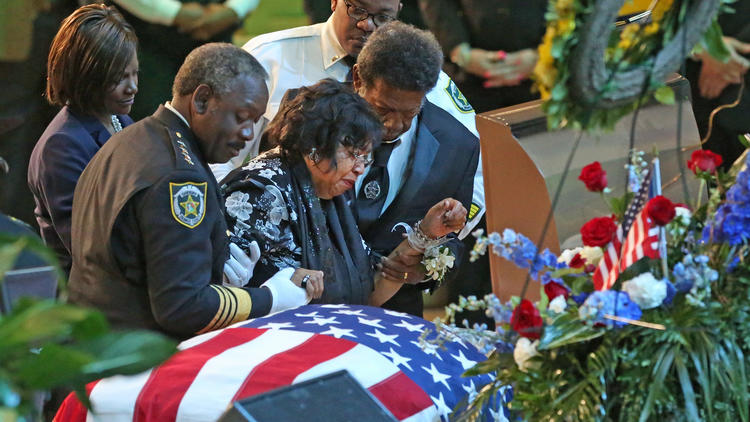 Pictures: Funeral services for OCSO deputy Norman Lewis