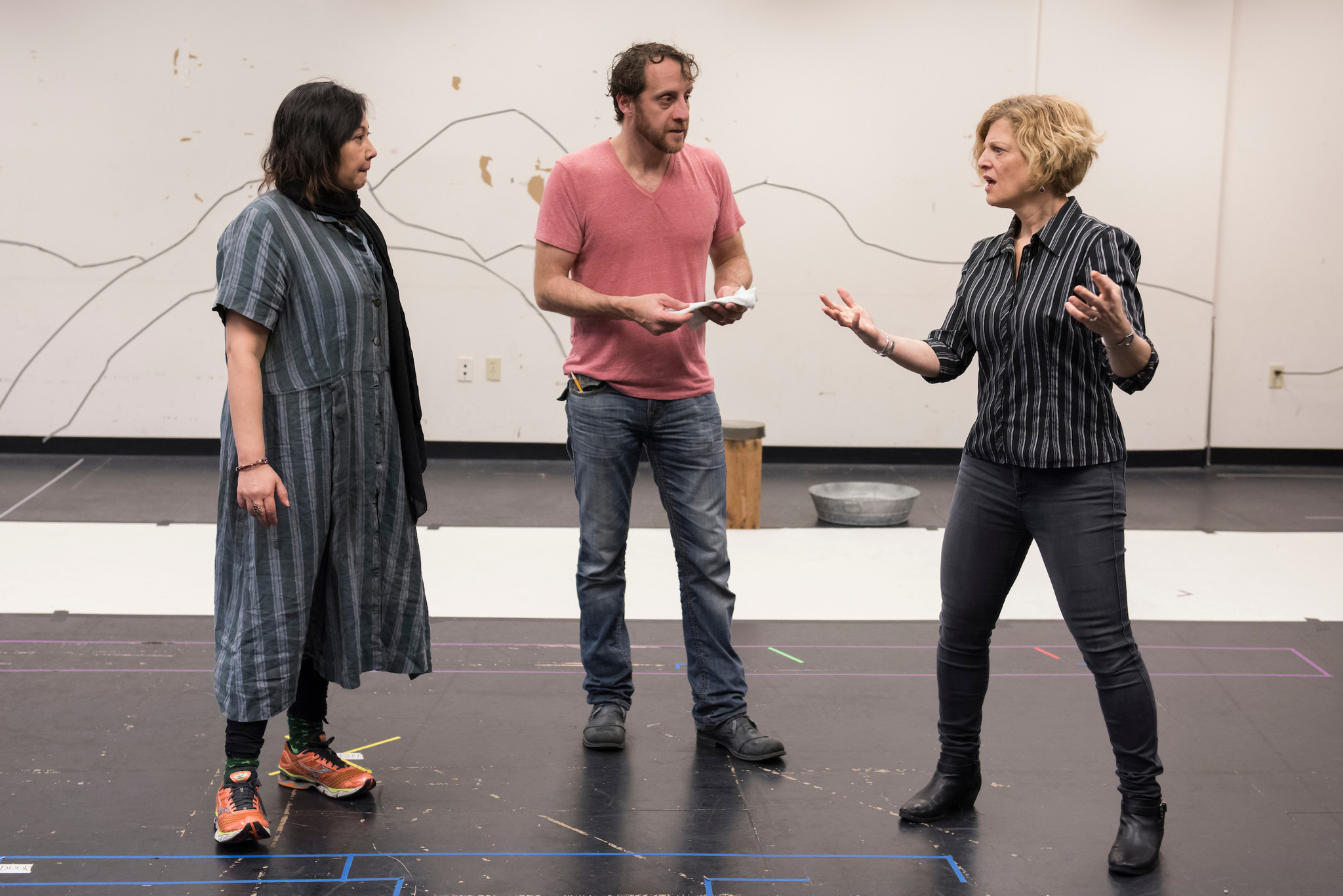 Carey Perloff, ACT's artistic director, right, rehearses a scene with actors Kate Rigg and Haysam Kadri.