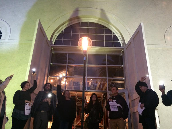 "Members of the Actors' Gang in Culver City turn on a ""ghostlight"" as a gesture of welcome. (Carolina A. Miranda / Los Angeles Times)"