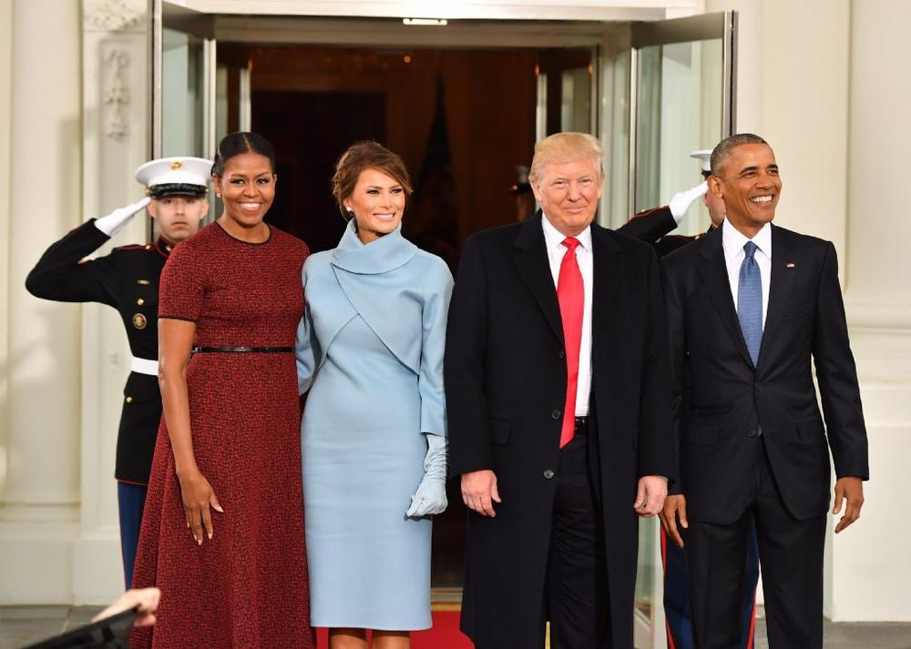 Melania Trump, second from left, wore an ensemble from the Ralph Lauren Collection on Inauguration Day. (Kevin Dietsch / EPA)