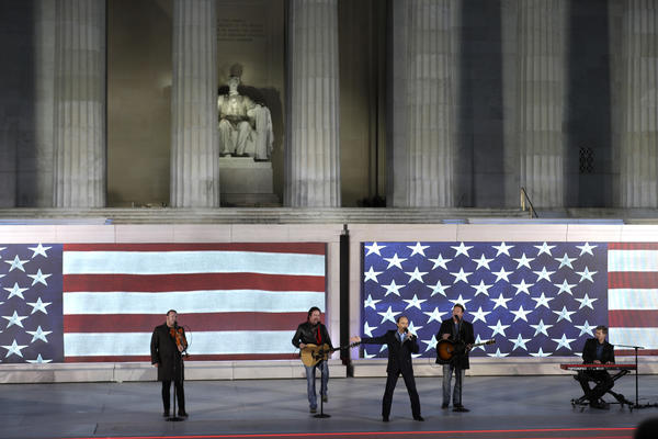 Lee Greenwood sings with the Frontmen of Country as part of Donald Trump's inaugural festivities on Thursday. (David J. Phillip / Associated Press)