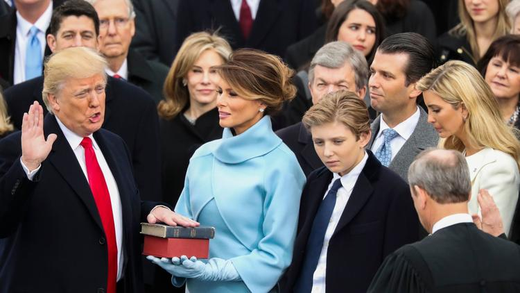 Donald Trump is sworn in as the 45th president of the United States by Chief Justice John Roberts on Friday at the Capitol. (Andrew Harnik / Associated Press)