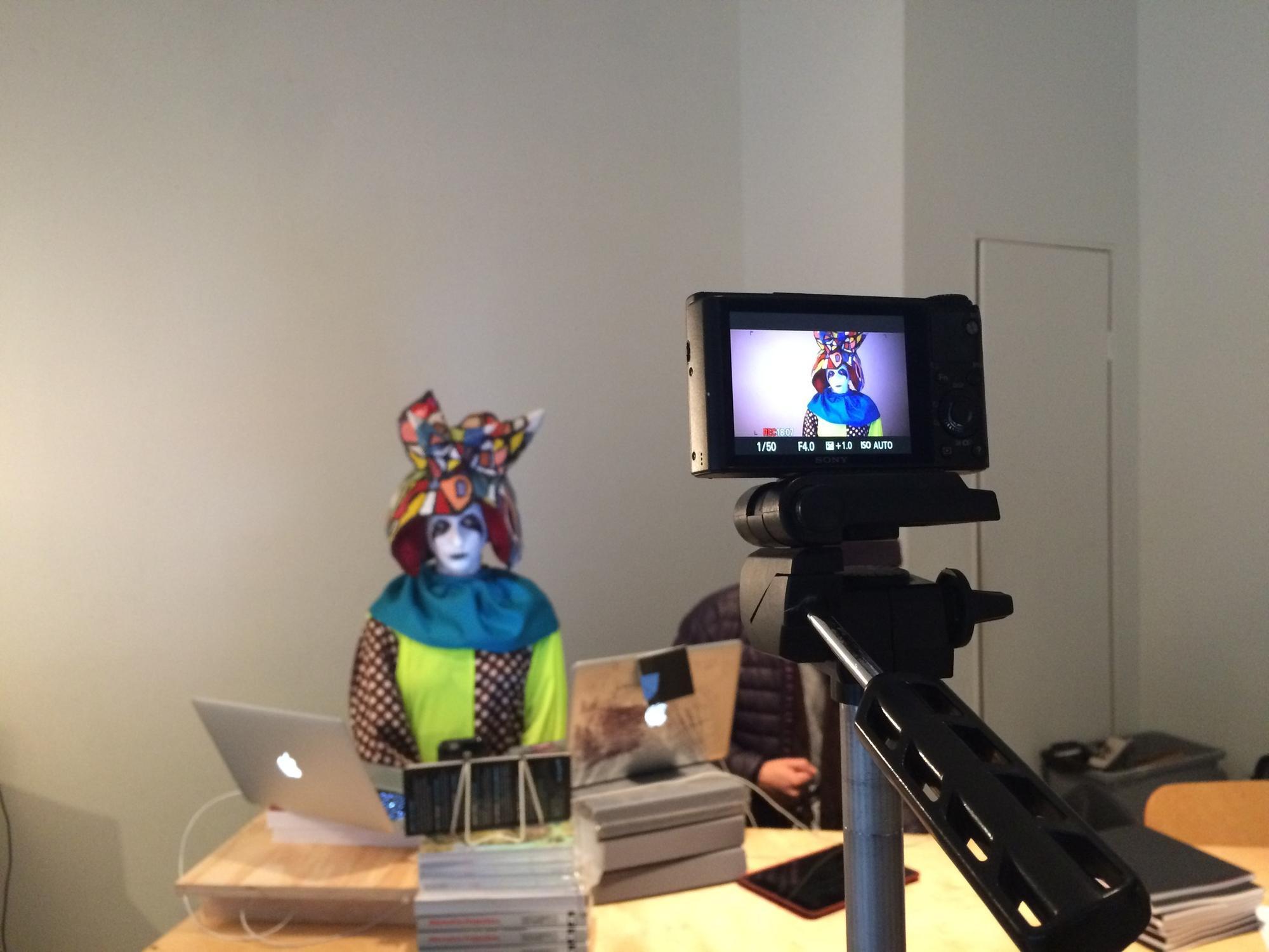 Artist Rachel Mason dressed up as her character FutureClown, preparing to lip-sync Trump's speech at LACE. (Carolina A. Miranda)