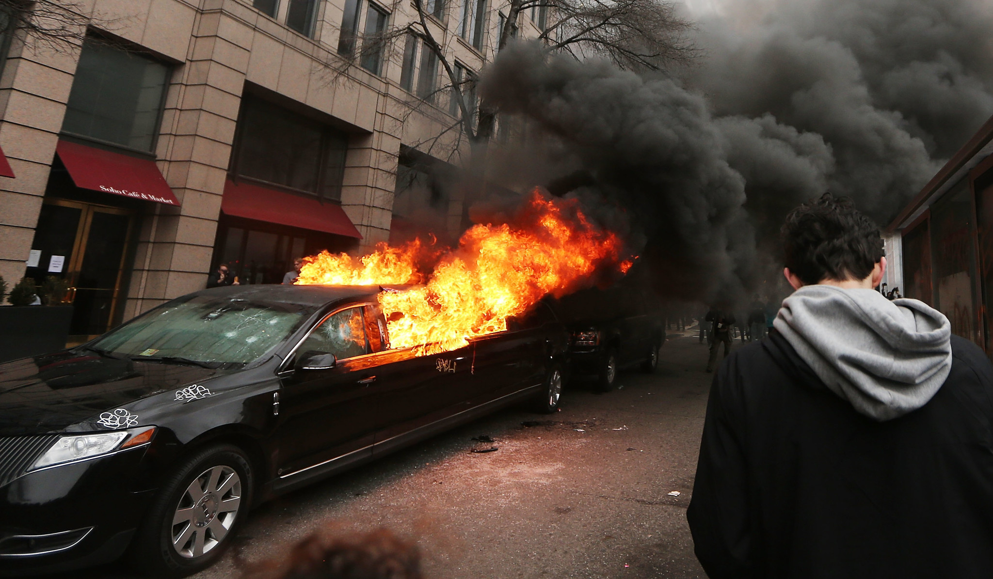 Angry protests and inaugural celebrations play out side by side in Washington