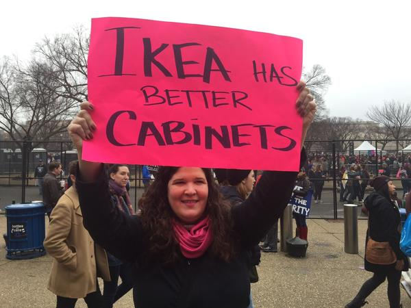 This protester took aim at Trump's Cabinet, the least diverse of recent administrations, both Democratic and Republican. It's the first since 1989 with no Latinos. (Steve Lopez / Los Angeles Times)