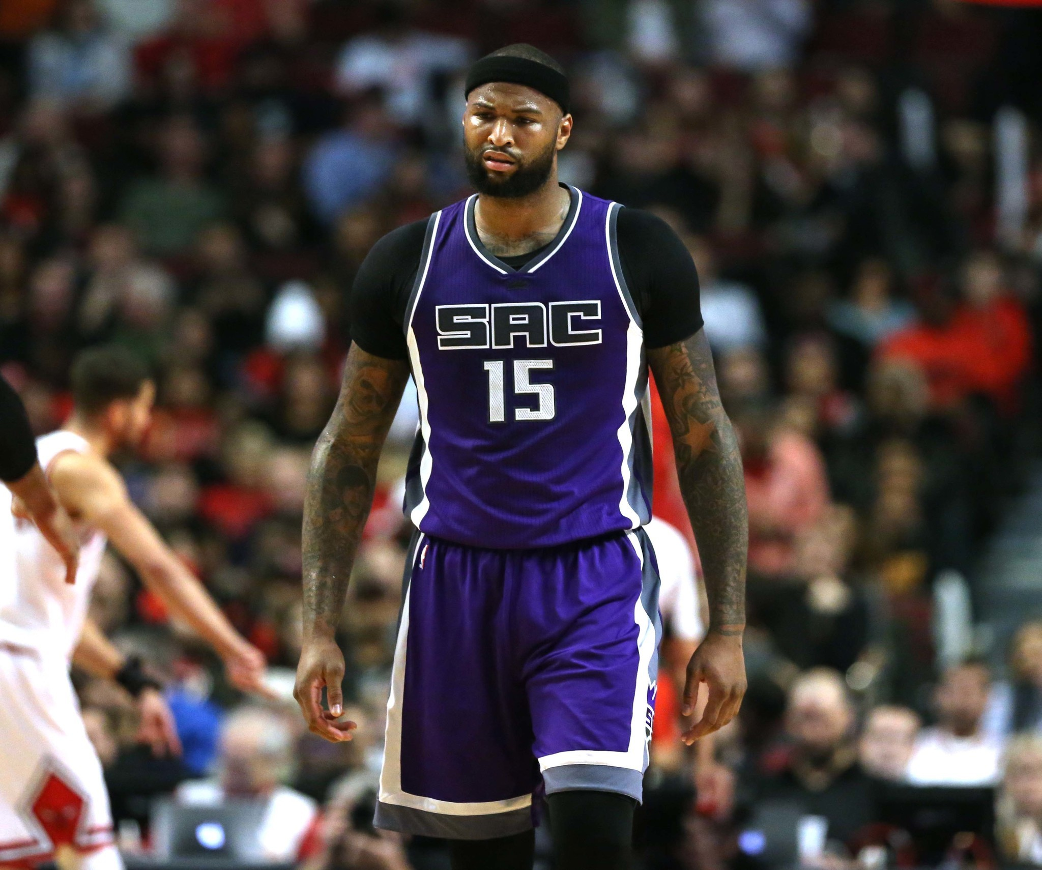 NBA rules DeMarcus Cousins didn't foul Dwyane Wade late in Saturday's game