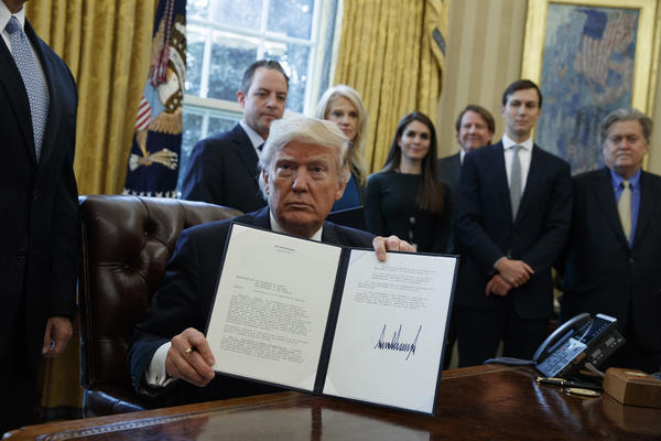 President Trump shows a signed executive order supporting the Keystone XL pipeline. None