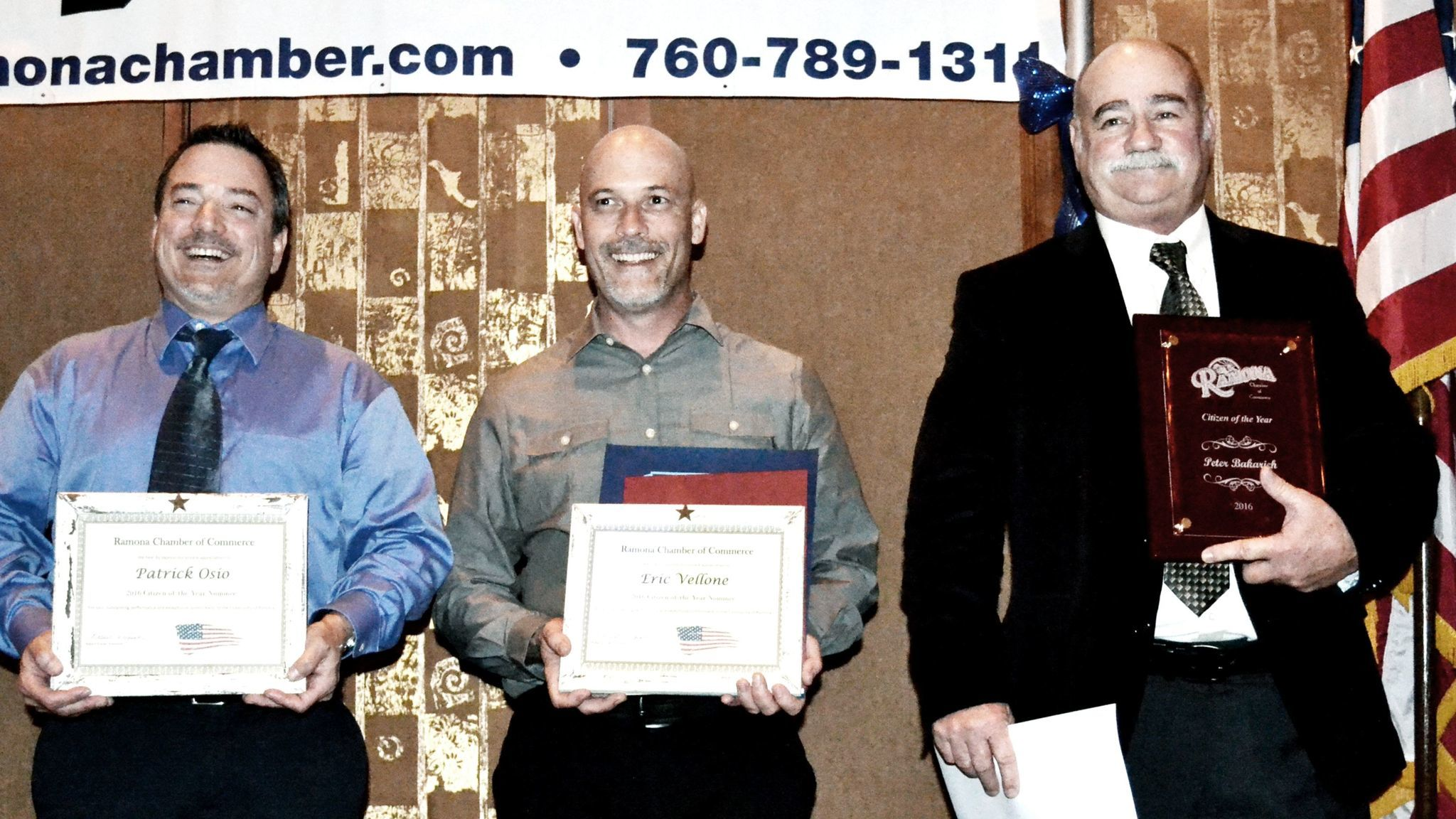 Pete Bakarich, president of Ramona Senior Center, chair of the senior center's Rib Fest, and community volunteer, right, smiles as he receives the chamber's Citizen of the Year award. Patrick Osio, left, and Eric Vellone show their certificates as nominees for the award.