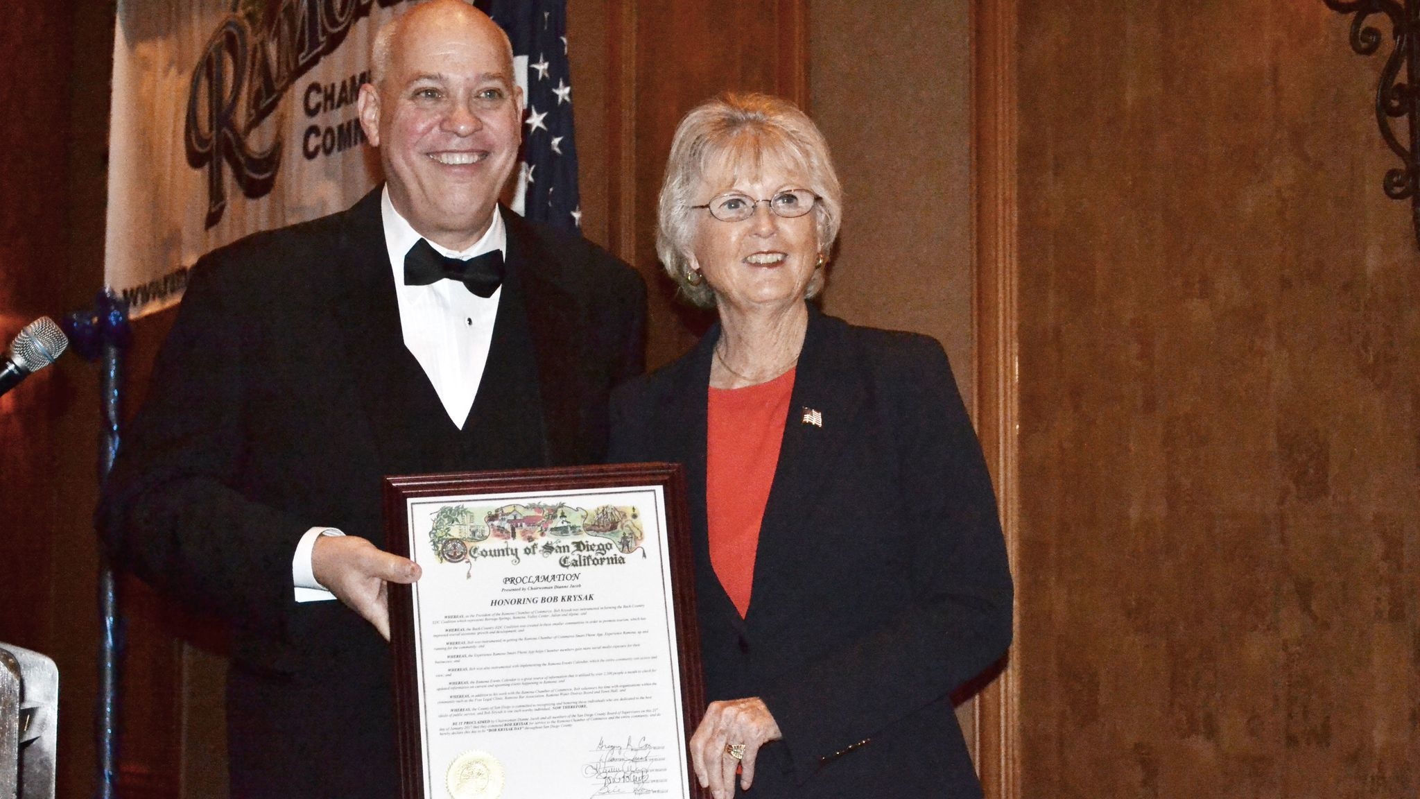County Supervisor Dianne Jacob presents a County of San Diego proclamation honoring outgoing Ramona Chamber of Commerce President Bob Krysak.