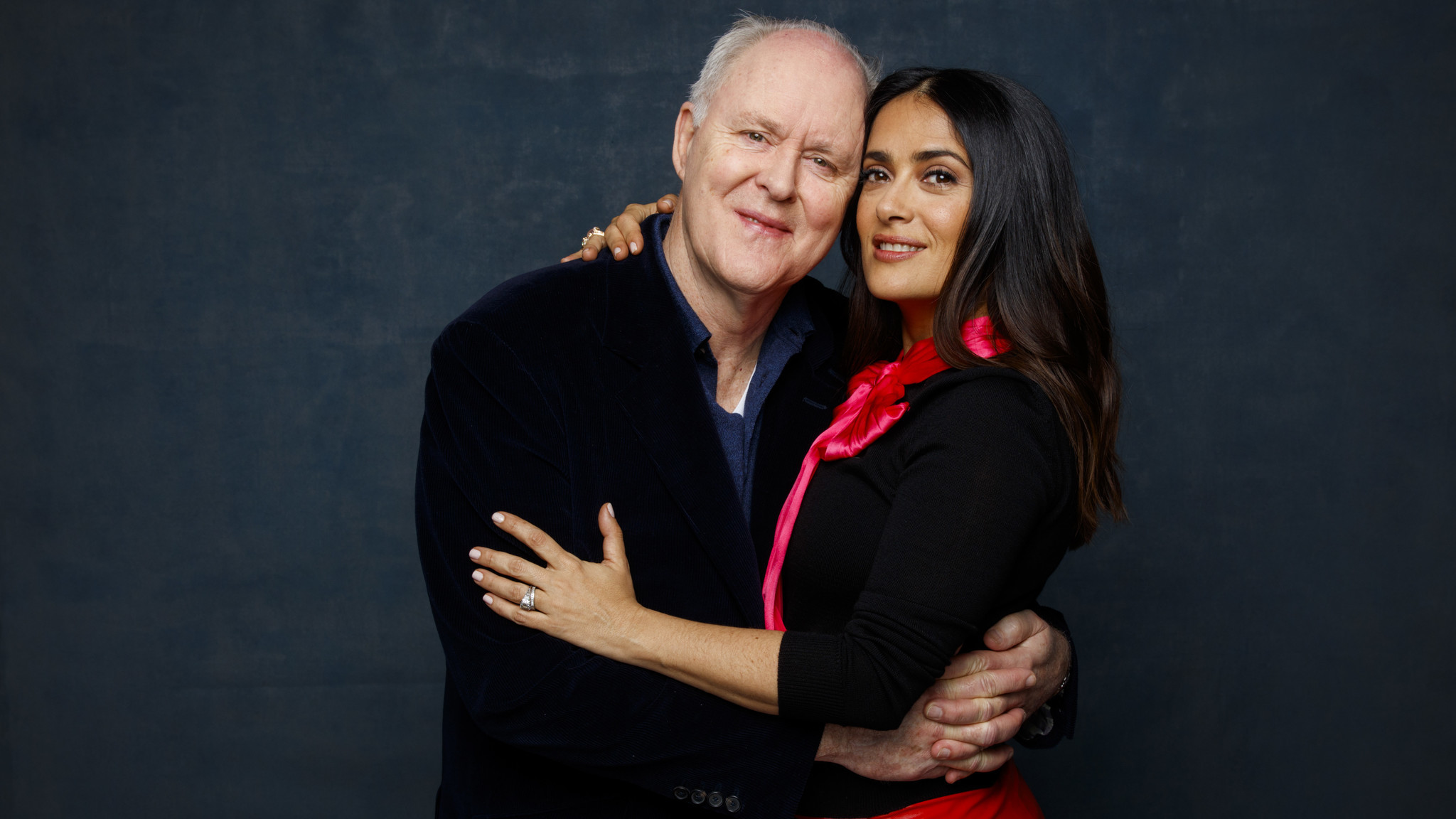 "John Lithgow and Salma Hayek, who star in ""Beatriz at Dinner,"" photographed in the L.A. Times photo studio during the Sundance Film Festival in Park City, Utah. (Jay L. Clendenin / Los Angeles Times)"