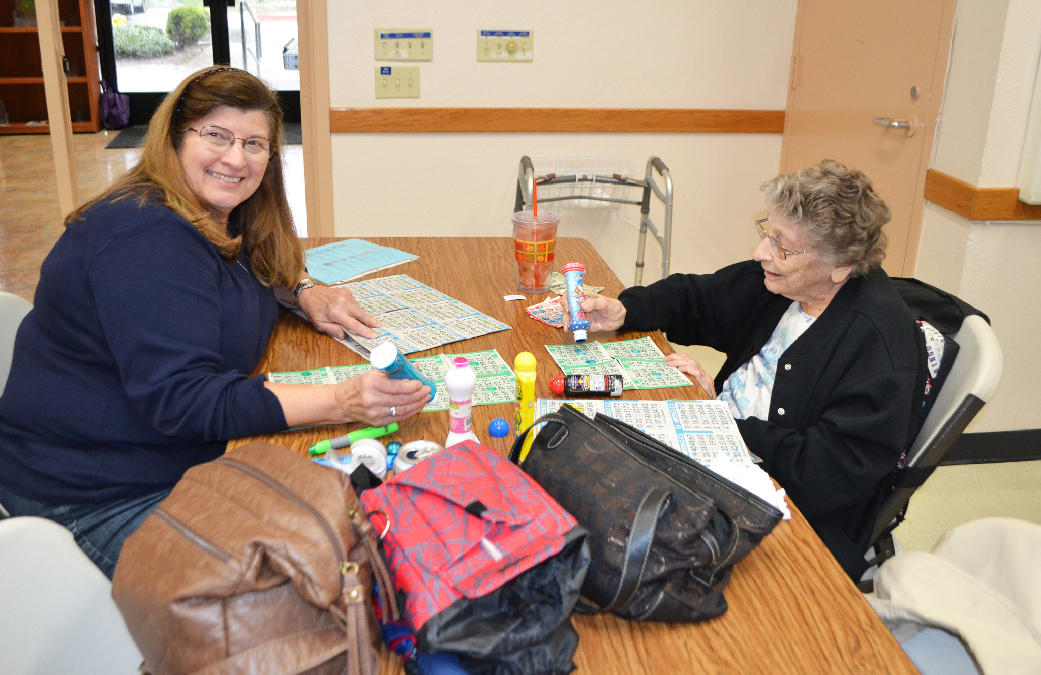 Susan Shaw and her mother, Nona Sturdy, playing bingo at the Ed Brown Center.